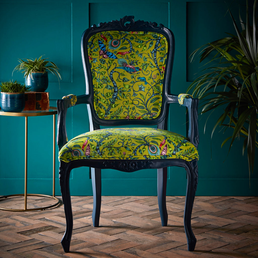 The striking velvet Rousseau Antoinette Chair is a striking maximalist piece of furniture, created by Emma J Shipley and Clarke & Clarke with the best selling Animalia collection of printed fabrics