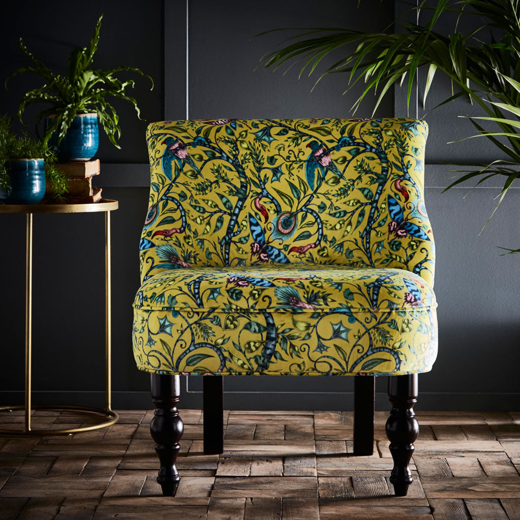 The Animalia collection fabric designs appear on Emma J Shipley for Clarke & Clarke's new furniture range - here is the Rousseau Langley Chair in lime