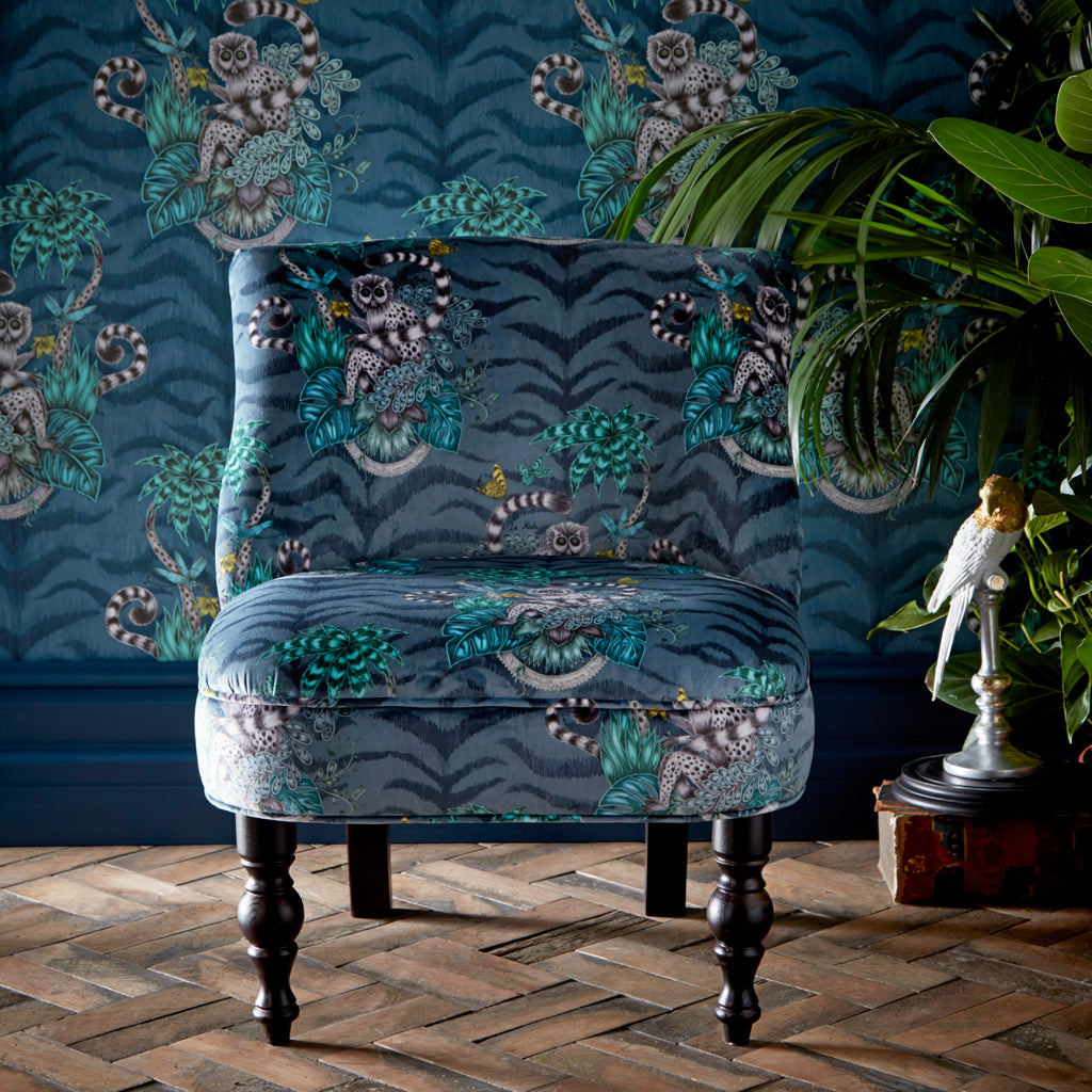 The Lemur Langley Chair is upholstered with the Navy lemur Velvet fabric from the Animalia collection, made by Emma J Shipley in collaboration with Clarke & Clarke