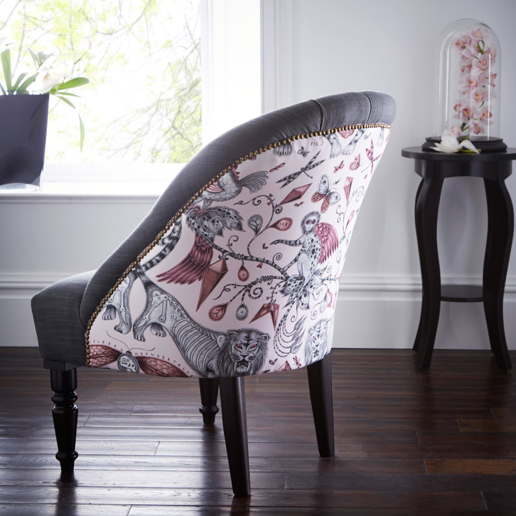 The Soho Chair in the pink Extinct design is a perfect bold statement to any interior space. It features a design inspired by the Ice Age by Emma J Shipley for Clarke & Clarke