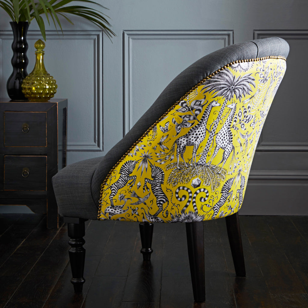 Lime Kruger cotton satin fabric upon the Soho Chair designed by Emma J Shipley for Clarke & Clarke is a perfect showstopper furniture piece for any interior space
