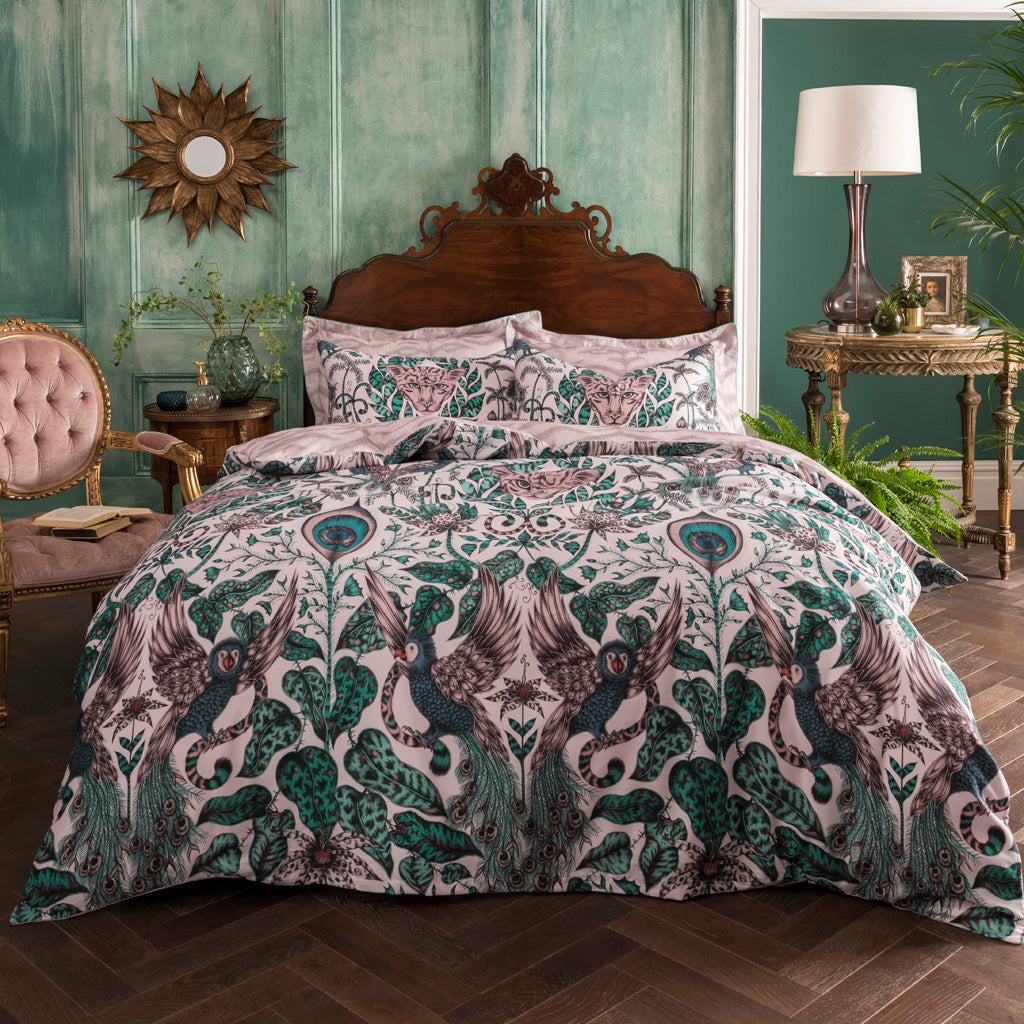 Enjoy two designs in one with the subtle pink, soft teals and blue Amazon print on the front, and a blush pink tiger-striped design on the back. Match with the Oxford pillowcases to complete the luxe layered look