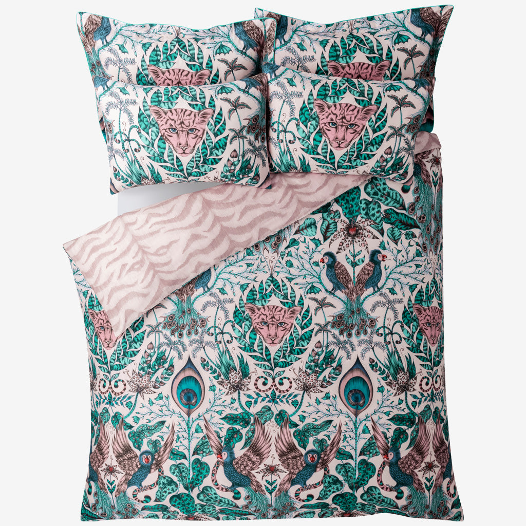 Enjoy two designs in one with the subtle pink, soft teals and blue Amazon print on the front, and a blush pink tiger-striped design on the back; perfect for adding a striking maximalist touch to any bedroom, complementing a huge array of colour schemes. Created in collaboration with Clarke & Clarke and John Lewis, limited numbers available.