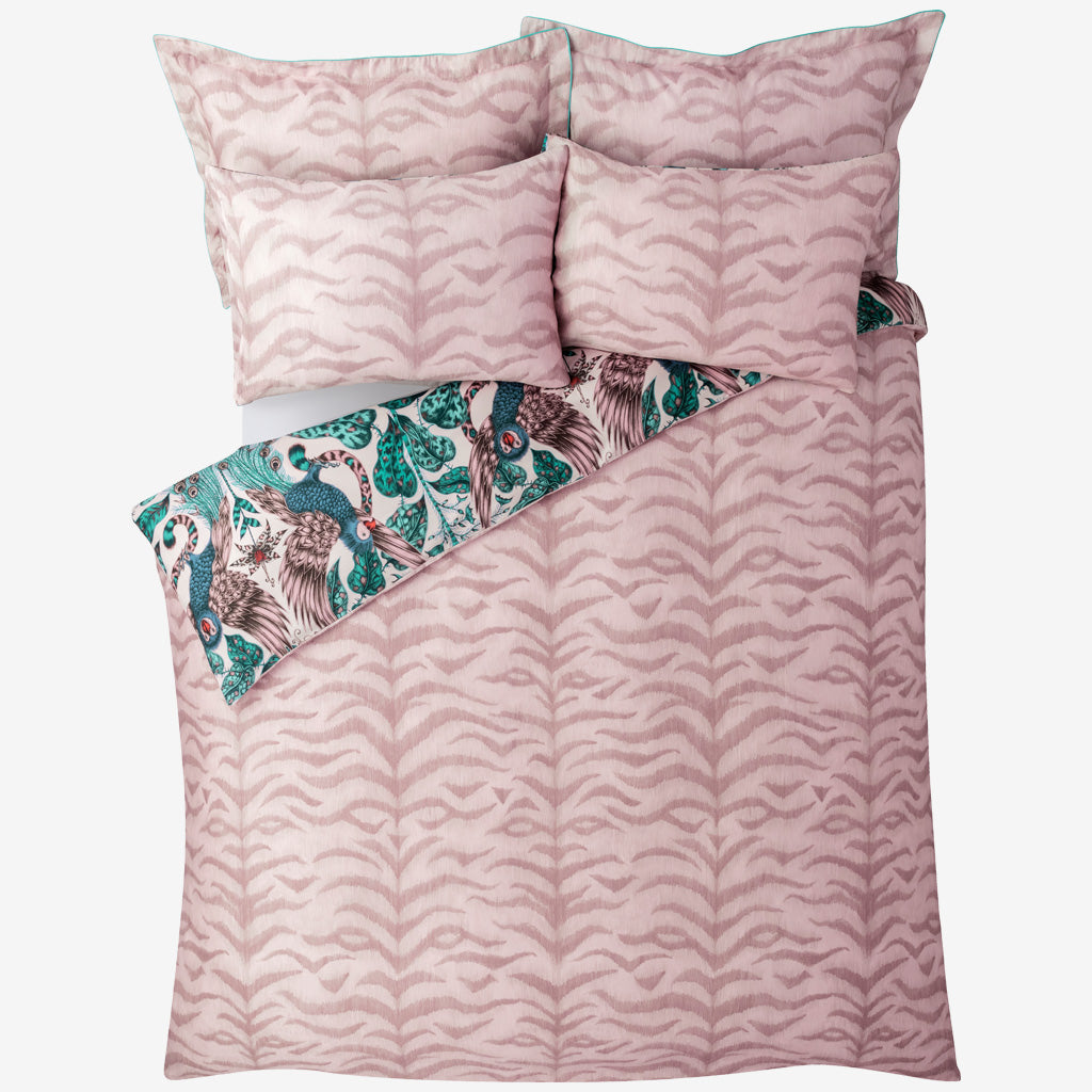 Transform your bed into a blush jungle paradise with the Amazon bedding in pink, featuring an exotic scene of creatures and foliage, with a tiger striped side. Created in collaboration with Clarke & Clarke and John Lewis