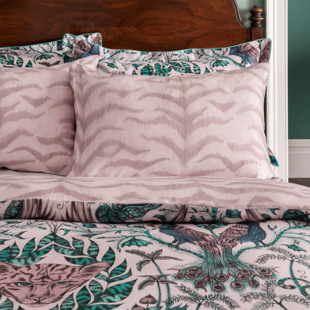 The reverse side of the Pillowcases tones with the subtle pinks, soft teals and blue Amazon print on the front and perfect for adding a touch of maximalism to a bedroom with an otherwise neutral colour scheme.