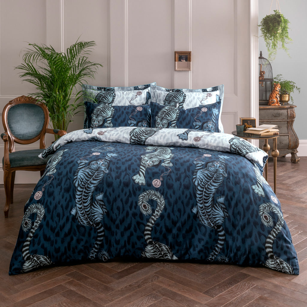 This signature design is printed onto a pair of 200 thread count cotton sateen reversible pillowcases. Enjoy two designs in one with the dramatic navy Tigris print on the front, and a contrasting soft blue design on the back.