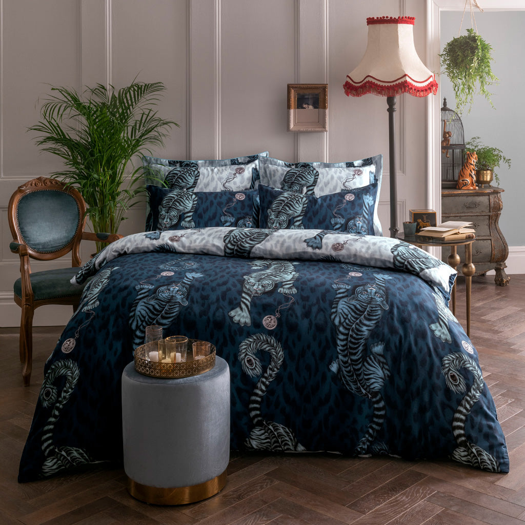 Transform your bed into a blue jungle paradise with the Tigris bedding in blue, featuring an exotic scene of Tigers and leopard print. Created in collaboration with Clarke & Clarke and John Lewis