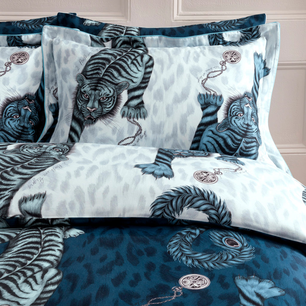 Transform your bed into a blue jungle paradise with the Tigris Oxford pillowcase in blue, featuring an exotic scene of Tigers and leopard print. Created in collaboration with Clarke & Clarke and John Lewis