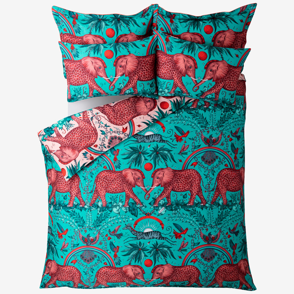 Transform your bed into a safari adventure with the reverse side of the Zambezi Oxford Pillowcase in turquoise blue, featuring an exotic scene of Elephants, rainbows & gazelles. Created in collaboration with Clarke & Clarke and John Lewis