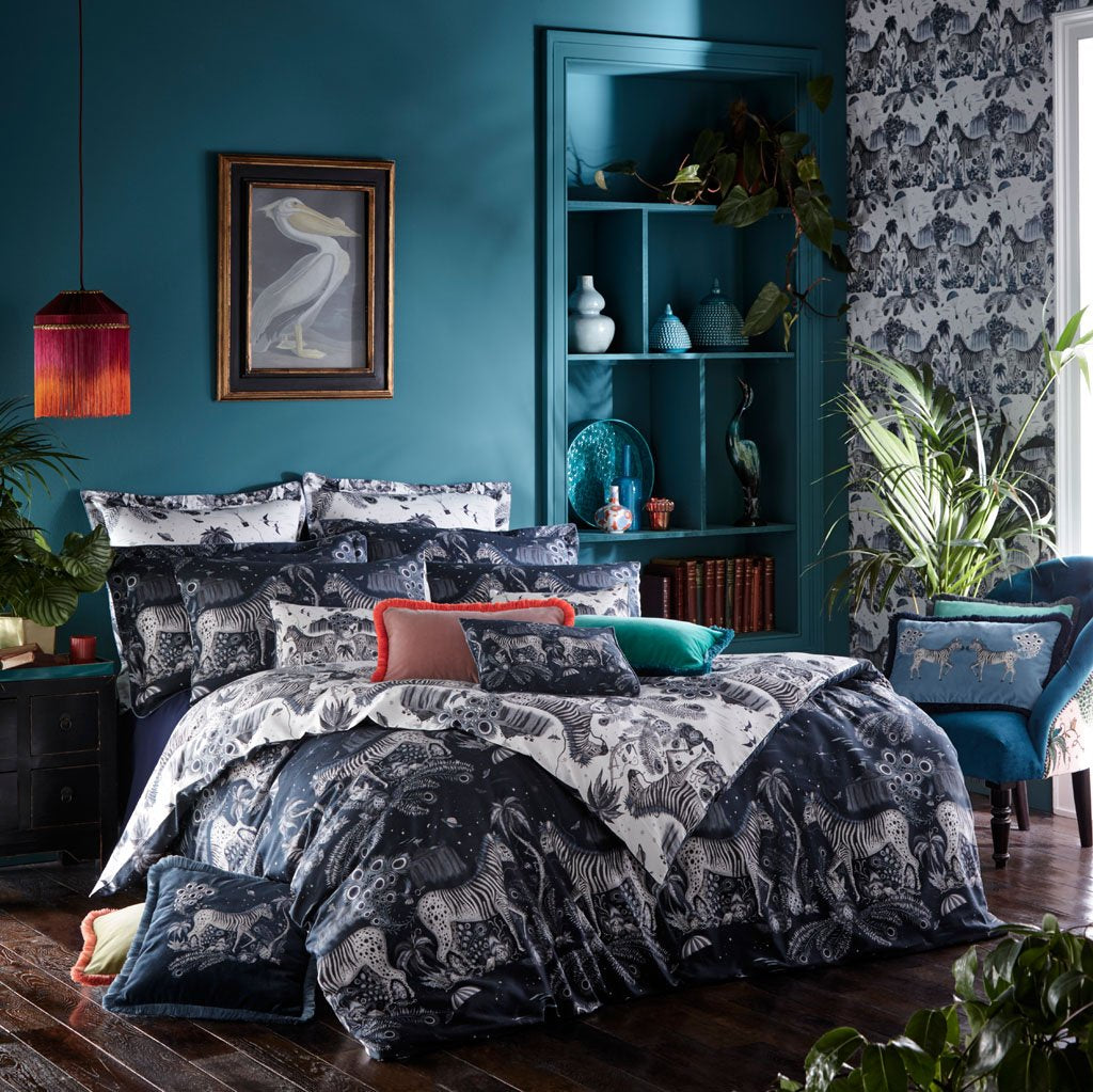 The Lost World Bedding has 2 different sides that both give very different look, use the deep navy side for a darker rich look and the other lighter monochrome blue side to create a fresher look in your bedroom. Designed by Emma J Shipley with Clarke & Clarke