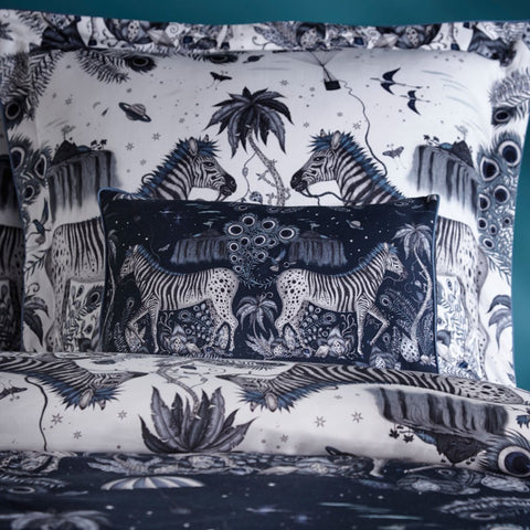 Emma J Shipley's printed Lost World Navy Boudoir pillowcase, is an exotic creation that will add a fantastical twist to your bed in an instant. The Dark Navy colour makes a great pillow to use on its own or to stack and layer along with other cushions and pillows.