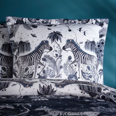 The Lost World Square Pillowcase in Monochrome Blue and navy is covered in Peacock tailed Zebras and mini floating parachutes, hand drawn by designer Emma J Shipley's travels. The hand-drawn illustration adorns the magical bedding set that guarantees to turn your bedroom into a maximalist dream world.