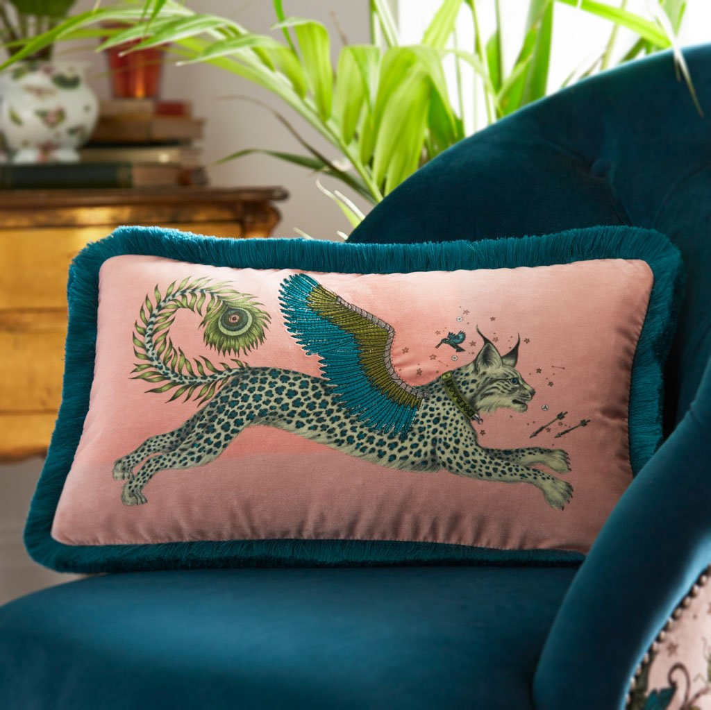 The Lynx Velvet Bolster Cushion in Pink with Teal Fringing is the perfect cushion to brighten up a lounge chair or to pile up on your bed to create a magic and comforting bed spread