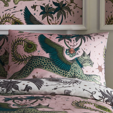 The Lynx Standard Pillowcase on Pink is covered in winged Lynx cats leaving through the sky, hand drawn by designer Emma J Shipley's travels. The hand-drawn illustration adorns the magical bedding set that guarantees to turn your bedroom into a maximalist dream world.