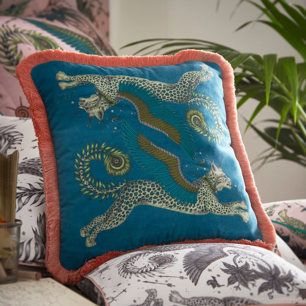 The Lynx Square Velvet cushion in Teal with Pink fringing is covered in a pair of winged Lynx cats leaping through the sky, hand drawn by designer Emma J Shipley's. The hand-drawn illustration adorns the magical cushion that guarantees to turn your bedroom into a maximalist dream world.