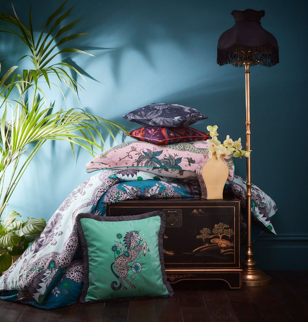 A stack of cushions that are all part of the new Emma J Shipley bedding range with Clarke & Clarke featuring some of her most popular designs such as Zambezi and Lynx as well as this Caspian Duvet Cover in Aqua.