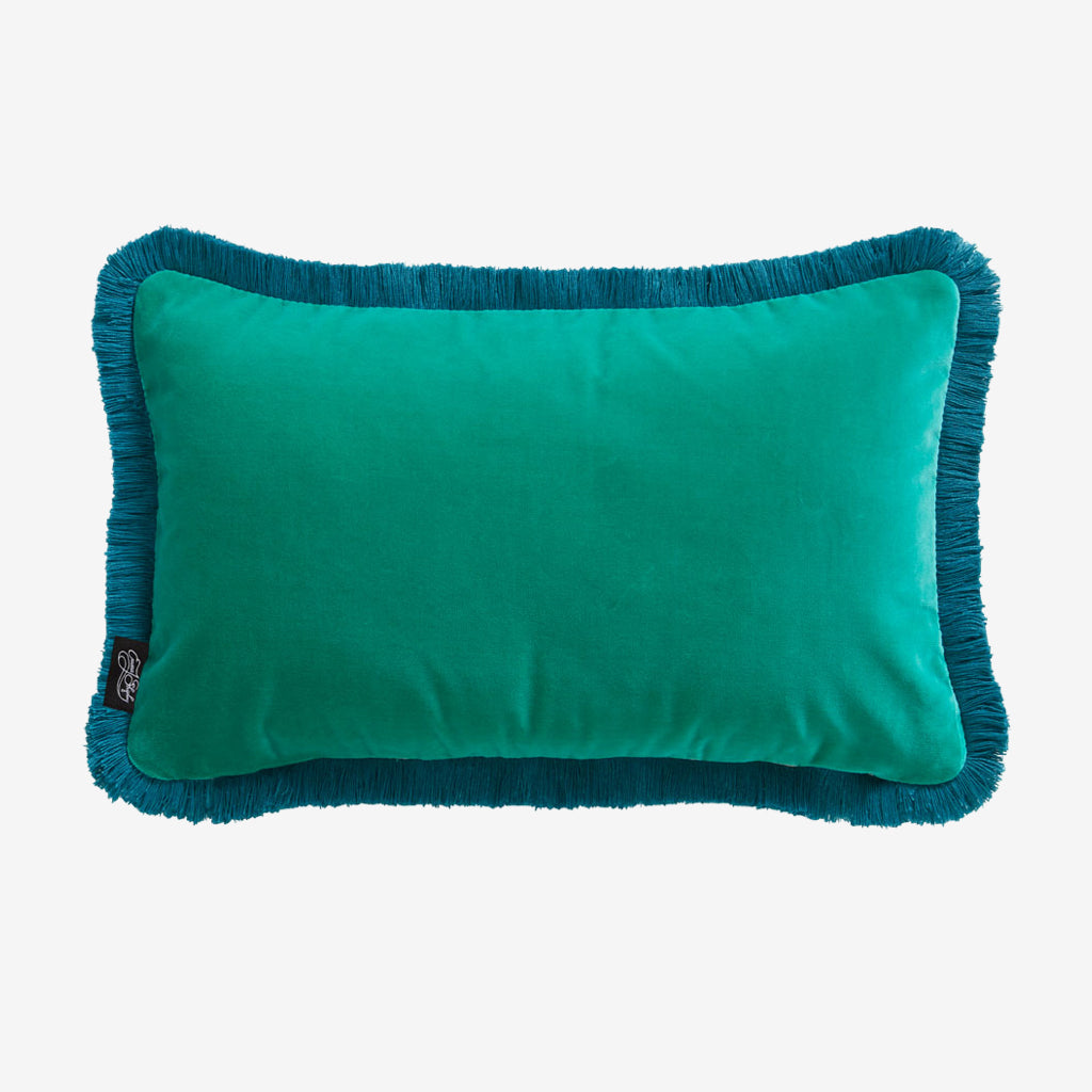 The reverse side of the Blush Caspian Velvet Bolster Cushion, beautifully illustrated by Emma J Shipley, made in collaboration with Clarke and Clarke, this shows the deep Teal side that pairs very well with the pink front and deep teal fringe