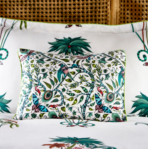 The Rousseau design appears on this Jungle Palms boudoir pillowcase, created by Emma J Shipley with CLarke & Clarke to create exotic, maximalist bedroom interiors