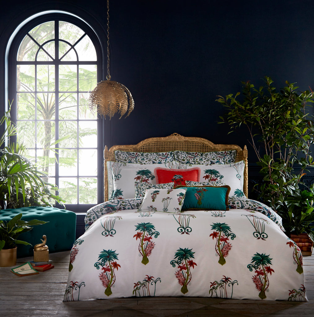 Exotic bedding featuring the Jungle Palms design, hand drawn by Emma J Shipley for Clarke & Clarke