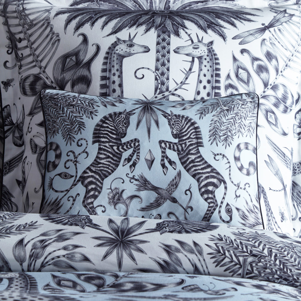 Two unicorn horned zebras in the hand drawn Kruger design printed on a charming egghsell blue boudoir pillowcase, designed by Emma J Shipley for Clarke & Clarke