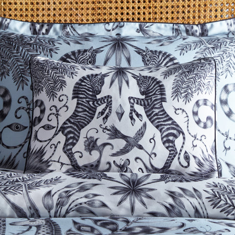The Kruger boudoir pillowcase in white shows magical unicorn zebras amidst a section of the Kruger design. Hand drawn by Emma J Shipley and created in collaboration with Clarke & Clarke
