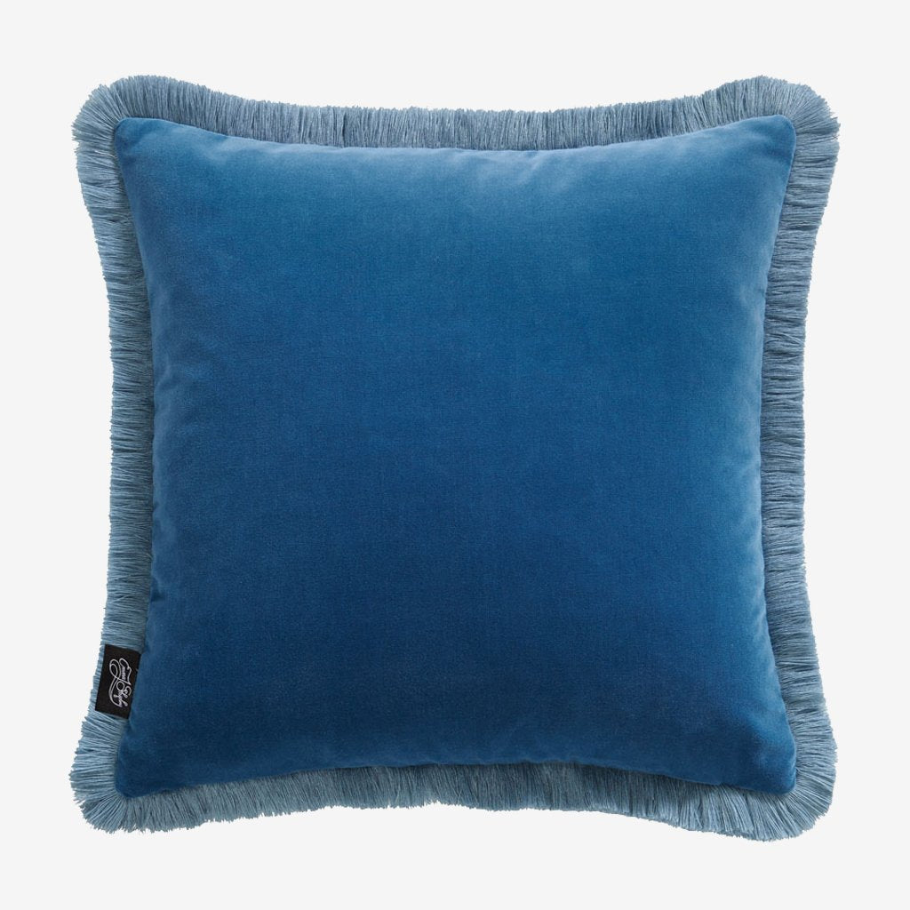 The reverse side of the Lost World Navy velvet cushion, designed by Emma J Shipley, made in collaboration with Clarke and Clarke, this shows the light magical Blue side that Pairs perfectly with the Night sky Navy fringing gives a very luxurious look to any seating area or bed spread