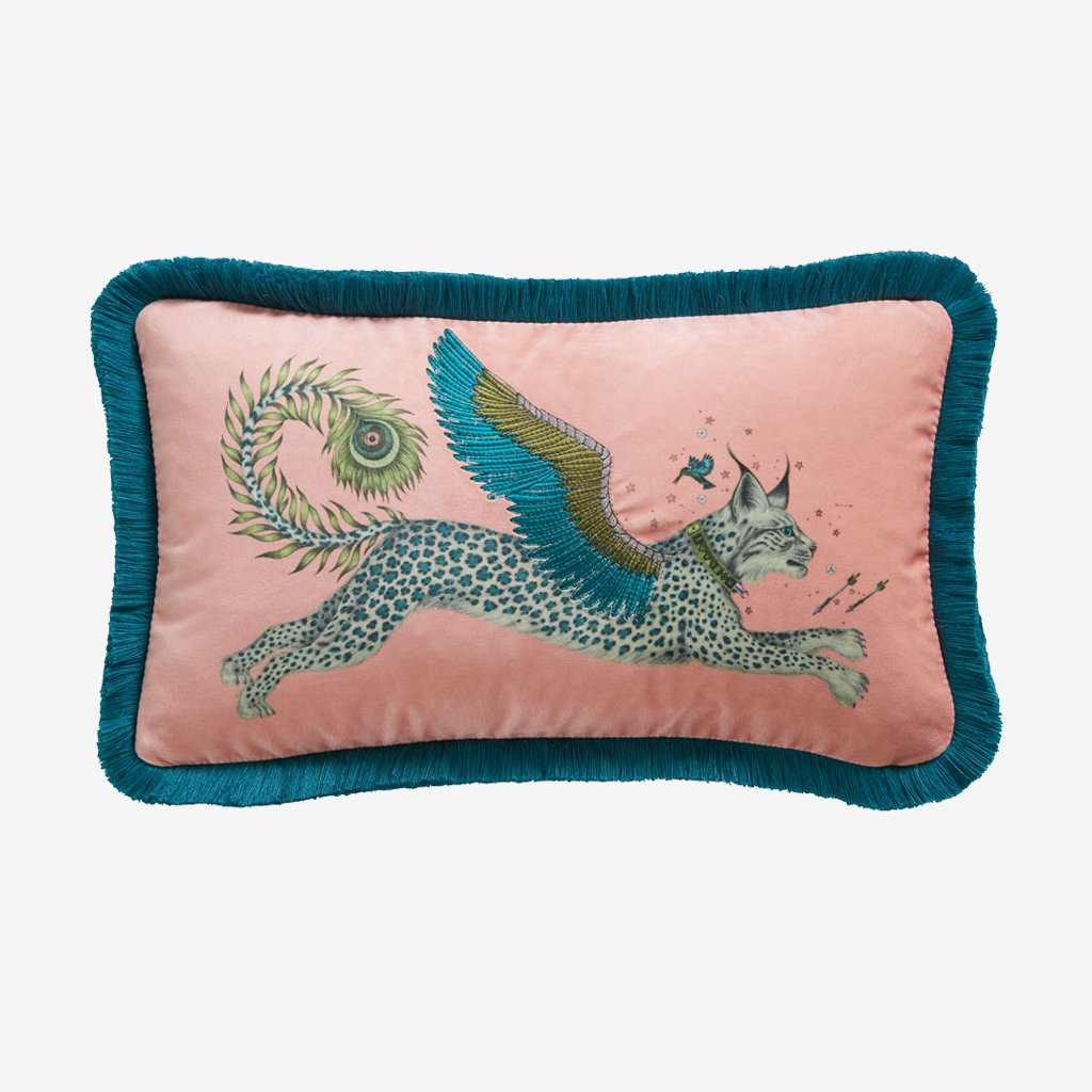 Transform your bedroom into a Magical Lynx inspired dream with the Lynx Velvet Bolster in Pink and Teal, designed by Emma J Shipley. Featuring a striking scene of creatures including a flying Winged Lynx with peacock tails.