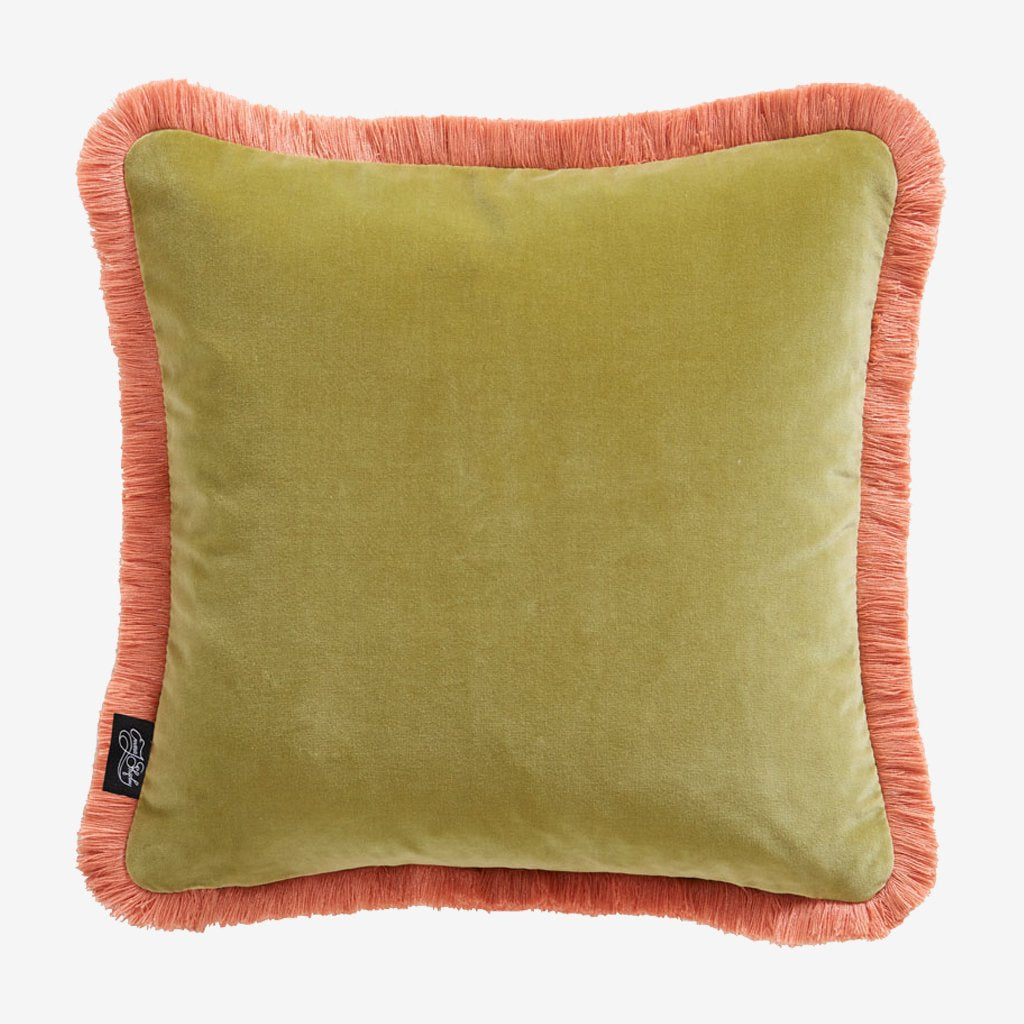 The reverse side of the Lynx velvet cushion, designed by Emma J Shipley, made in collaboration with Clarke and Clarke, this shows the light magical chartreuse side that Pairs perfectly with the pink fringing gives a very luxurious look to any seating area or bed spread