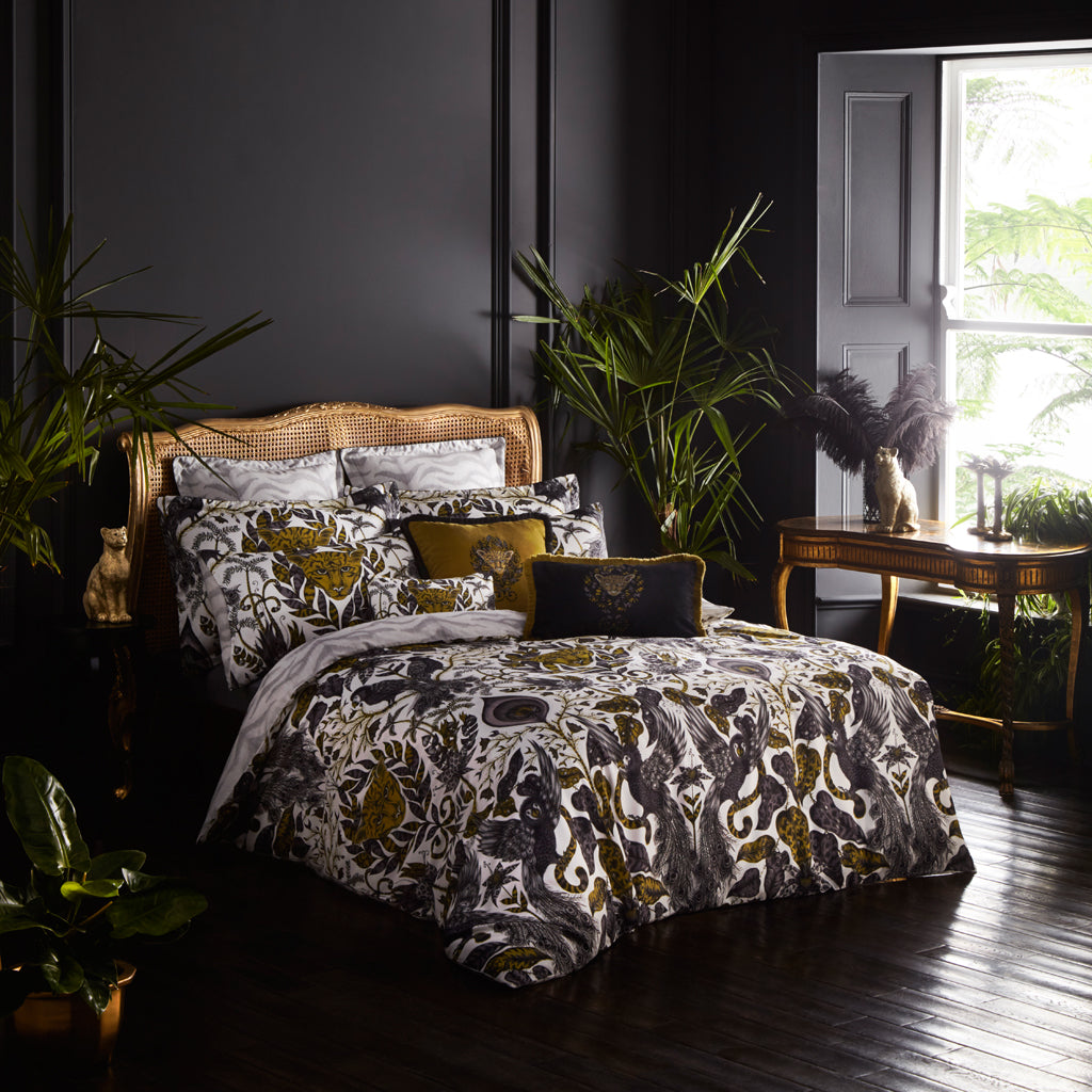 The beautiful gold Amazon bedding set in a beautiful dramatic tropical bedroom