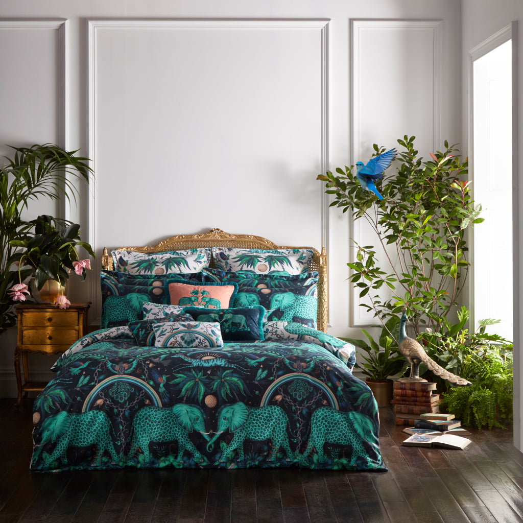 The tropical teal Zambezi design upon this luxury bedding set designed by Emma J Shipley for Clarke & Clarke