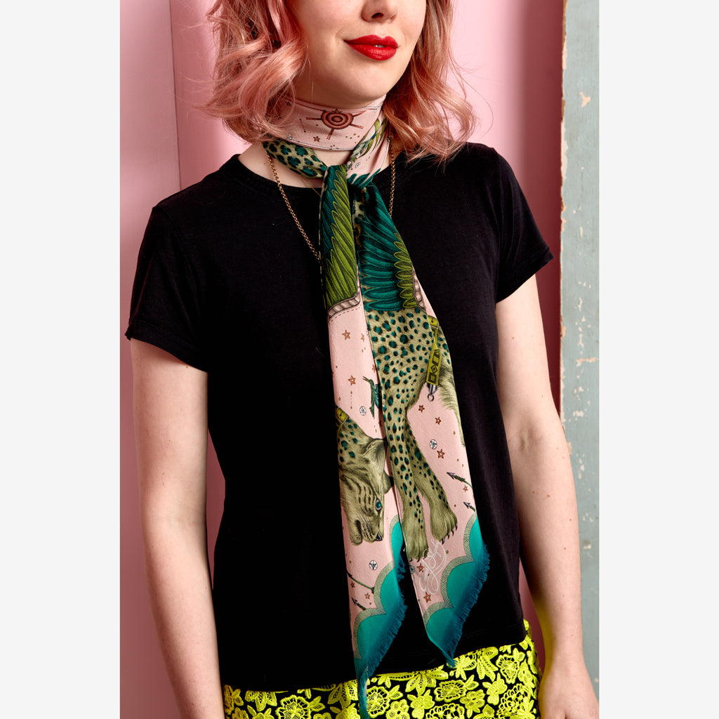 Emma J Shipley wearing the exotic Lynx silk skinny scarf in an imaginative palatte of tonal pink and a range of greens