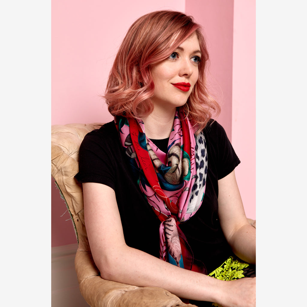 Emma J Shipley wearing the striking Protea Silk Chiffon pink Scarf