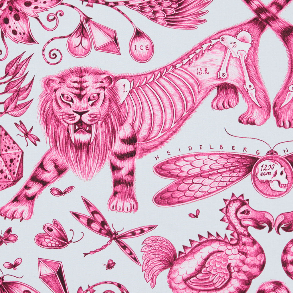 The anatomical style maximalist Extinct design on our new range of cotton satin fabrics in collaboration with Clarke & Clarke in the magenta colour way