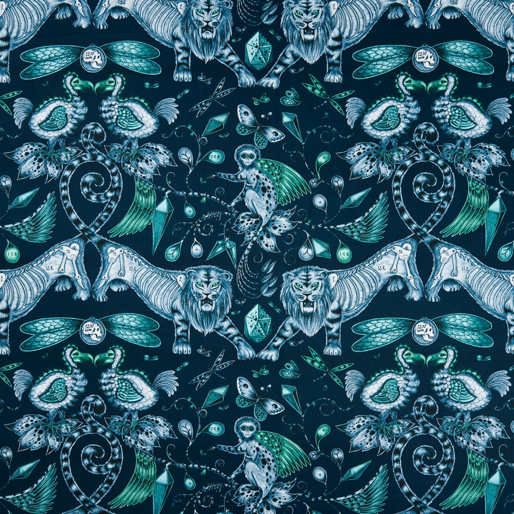 The mysterious, opulent Extinct design on our new range of cotton satin fabrics in collaboration with Clarke & Clarke in navy with highlights of teal and forest green