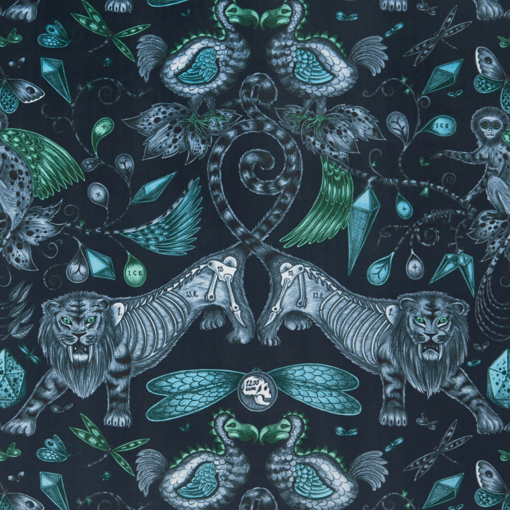 The luxurious navy Extinct velvet fabric designed by Emma J Shipley x Clarke & Clarke in the Animalia collection