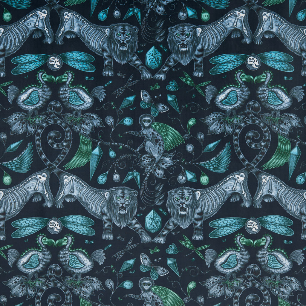 The maximalist, luxurious navy Extinct velvet fabric designed by Emma J Shipley x Clarke & Clarke in the Animalia collection