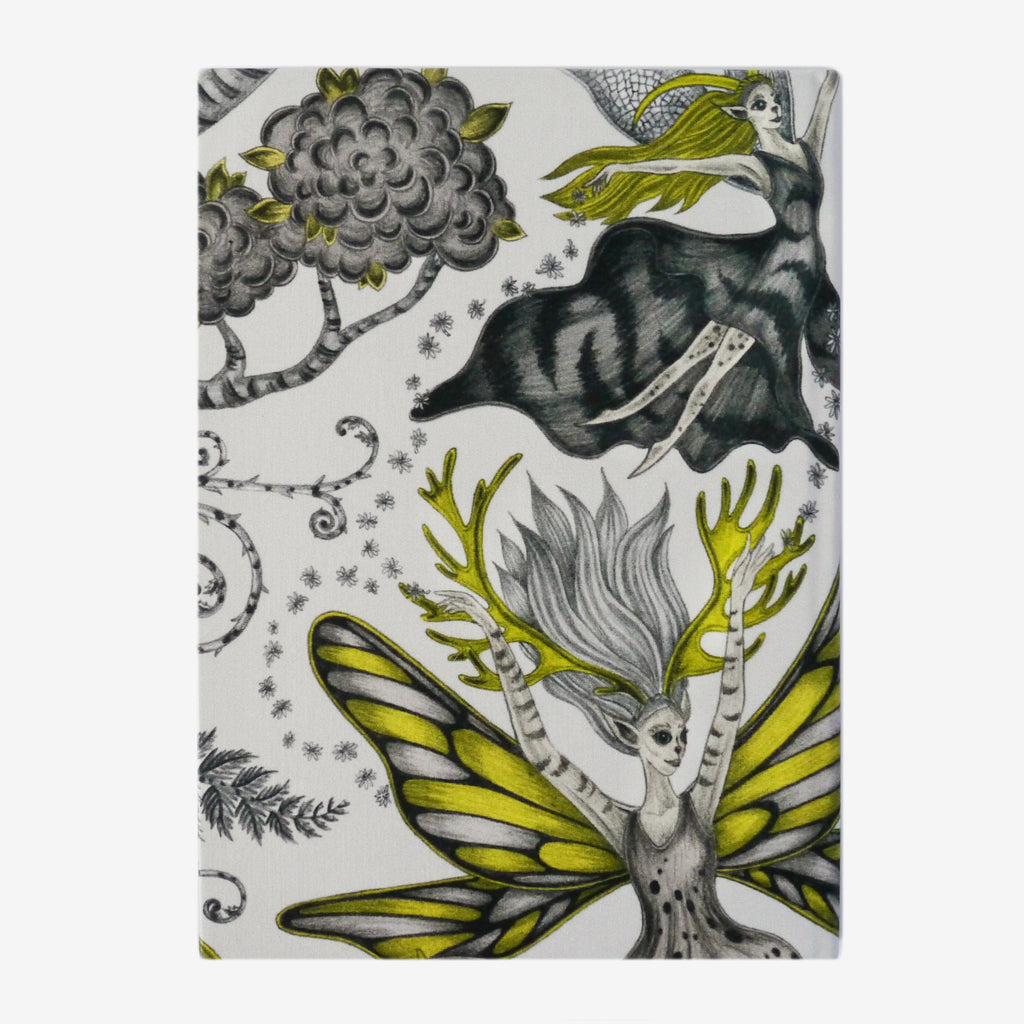 The Elven Silk Notebook designed by Emma J Shipley features a group of dancing fairies in gold, grey and monochrome tones