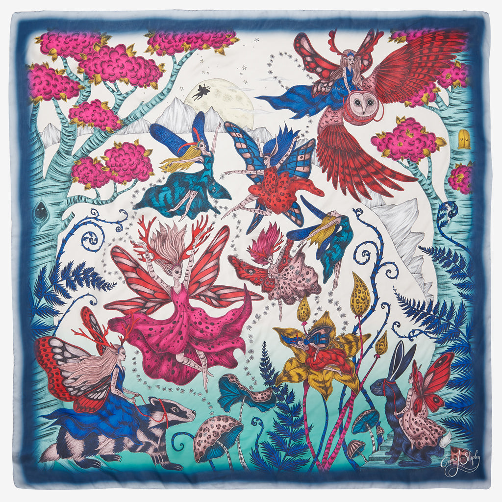 The Elven Silk Chiffon Scarf designed by Emma J Shipley features an array of magical, dancing fairies among a multicoloured enchanting forest scene