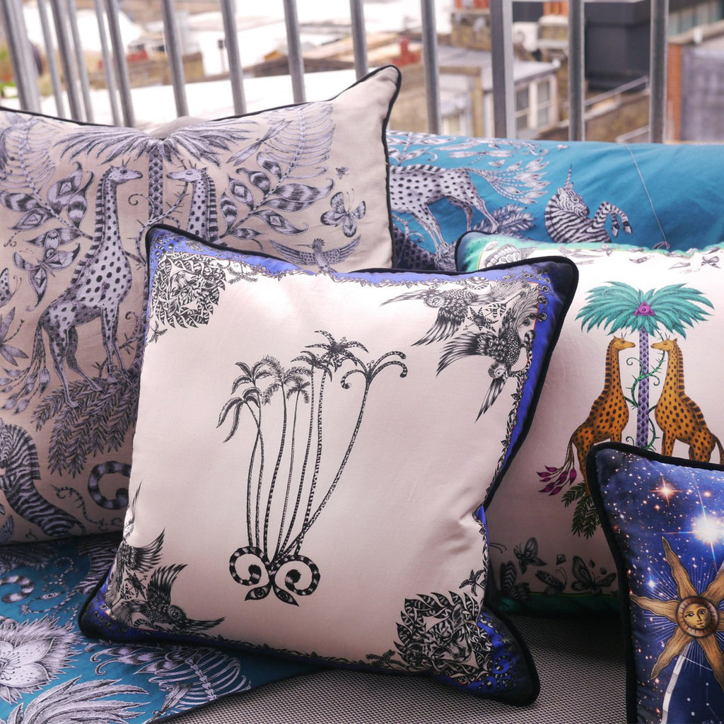 A lifestyle photo of Emma J Shipley's luxurious Amazon Palms Printed Cushion, the perfect addition to your home