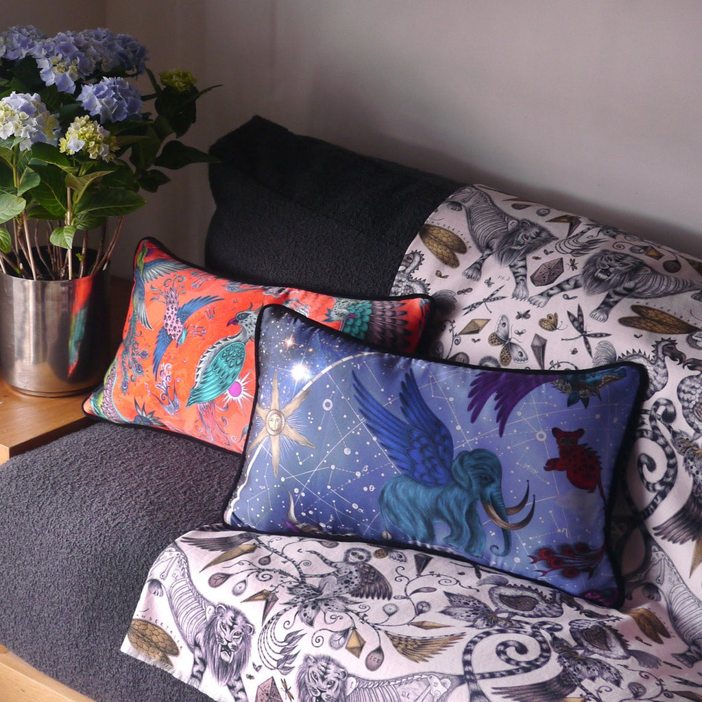 A lifestyle photo of Emma J Shipley's luxurious silk and cotton printed Phoenix Bolster cushion collection, the perfect addition to your home