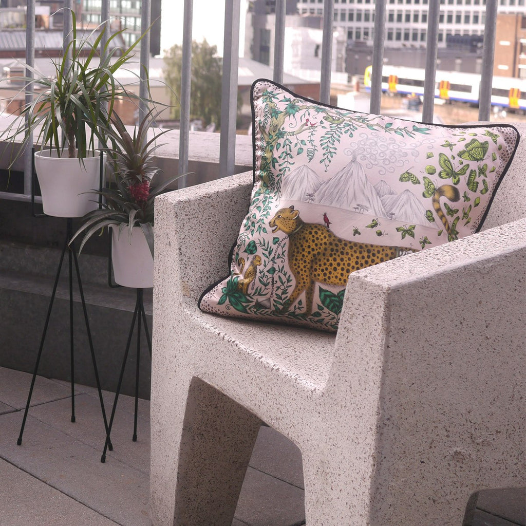 A lifestyle image of Emma J Shipley's luxurious Cheetah Printed Cushion, the perfect gift this Christmas.