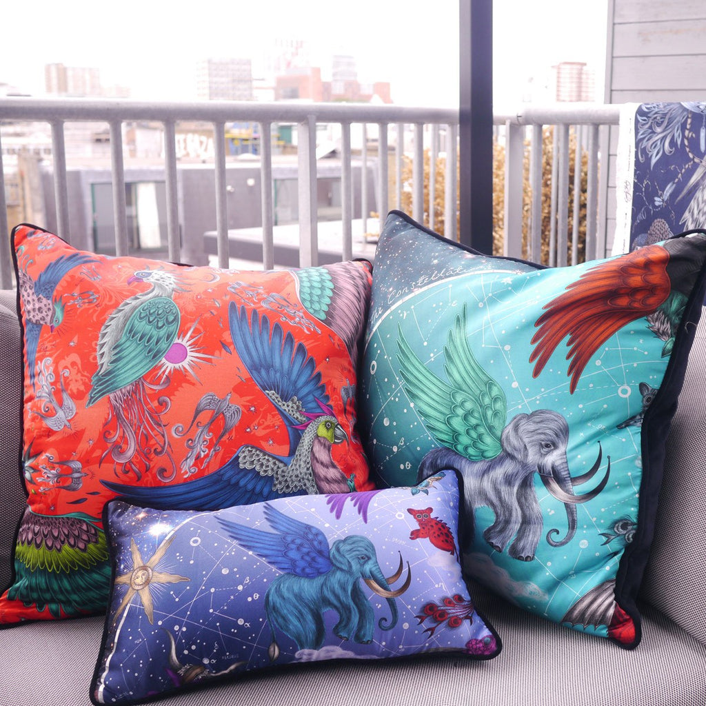 A lifestyle image of Emma J Shipley's luxurious Constellation Cushion, a perfect gift for your sofa.