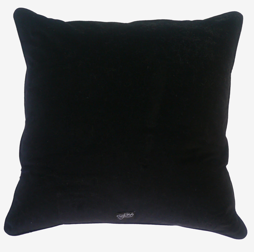 The luxurious black velvet backing of the Emma J Shipley Cotton and Silk Phoenix Cushion, complete with a logo label at the bottom.