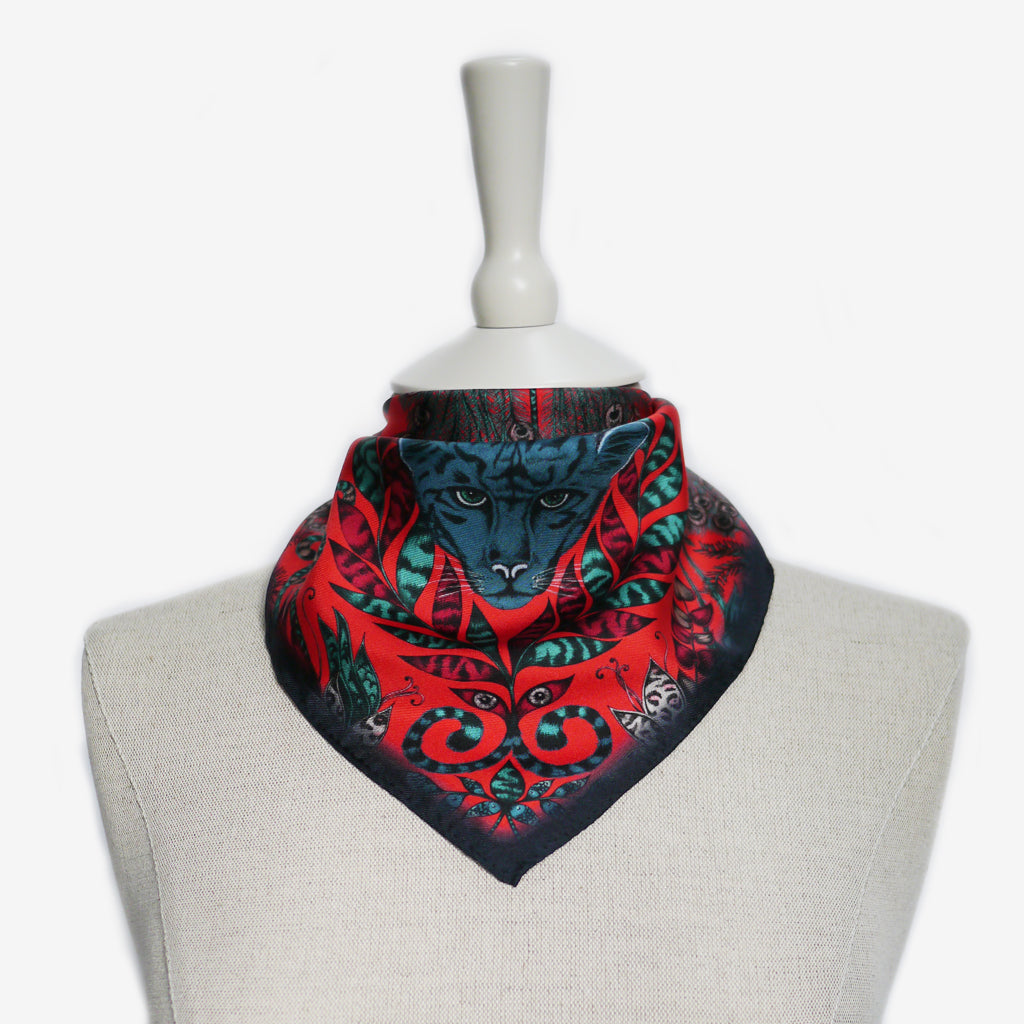 A tied example of the Amazon Silk Neckerchief by Emma J Shipley, taken from the Heroes collection.