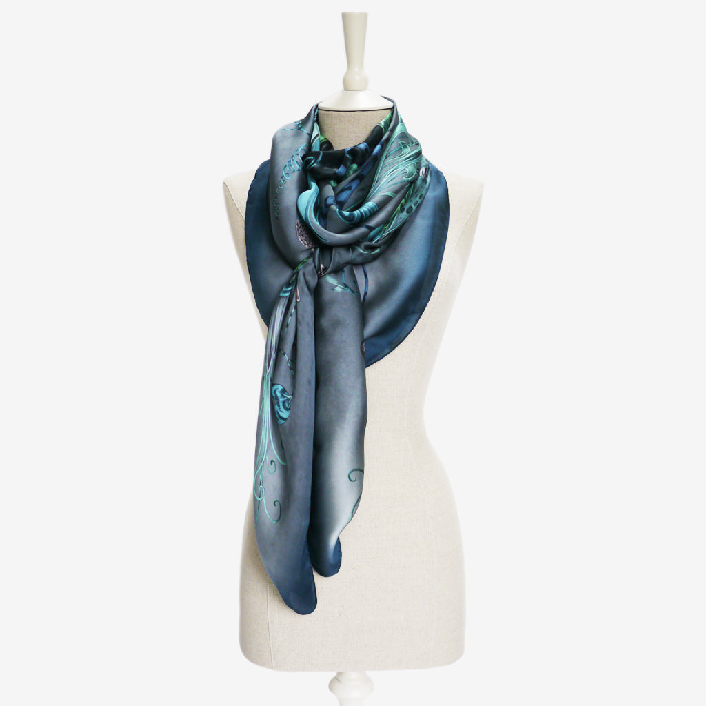 A tied example of the Audubon Silk Chiffon Scarf by Emma J Shipley, taken from the Heroes collection.