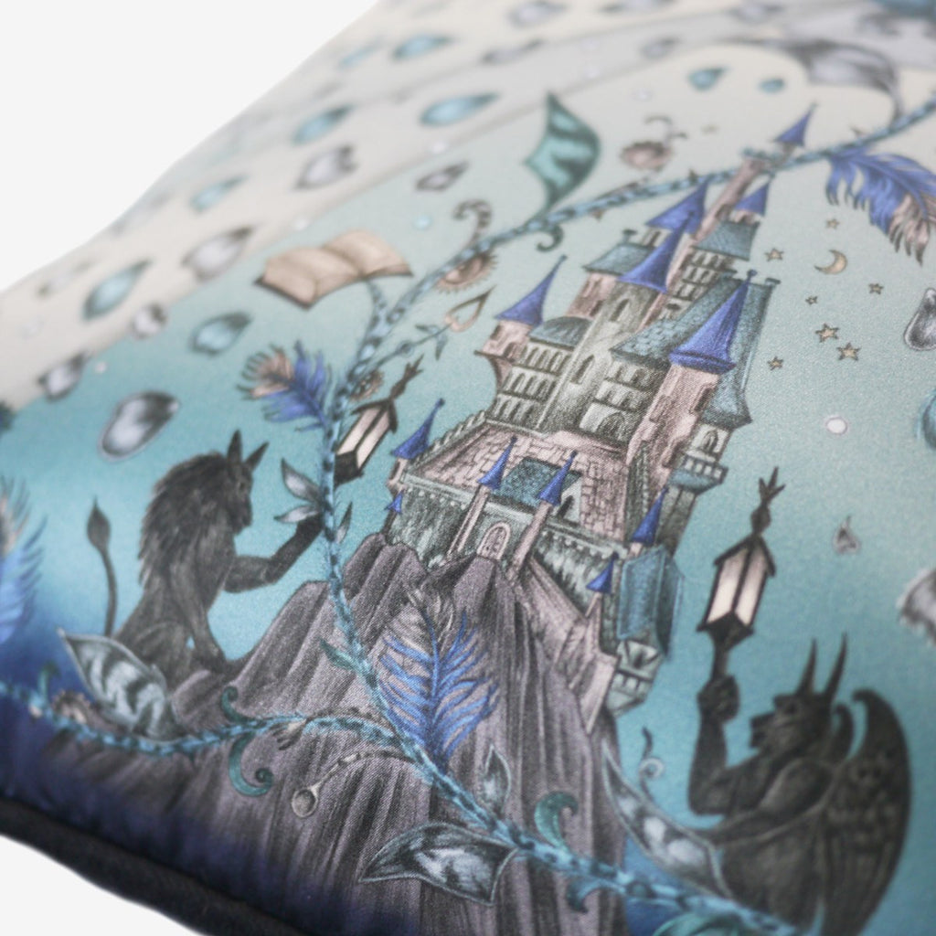 Detailed image of the enchanting castle illustration featured on the Disney x Emma J Shipley Beauty and the Beast cushion in Blue.