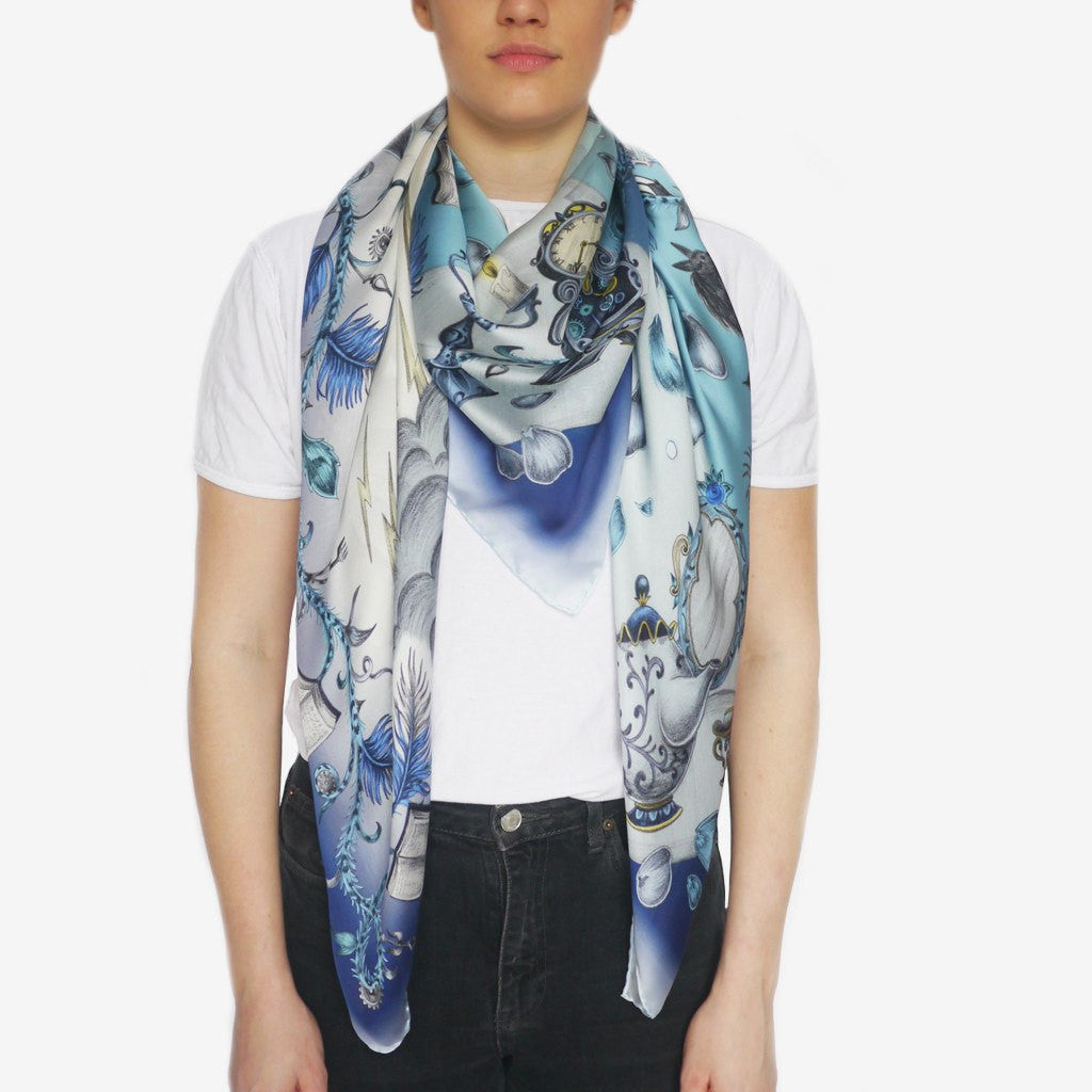 A worn photograph of the Beauty and the Beast Silk Chiffon scarf in Blue by luxury designer and illustrator Emma J Shipley.
