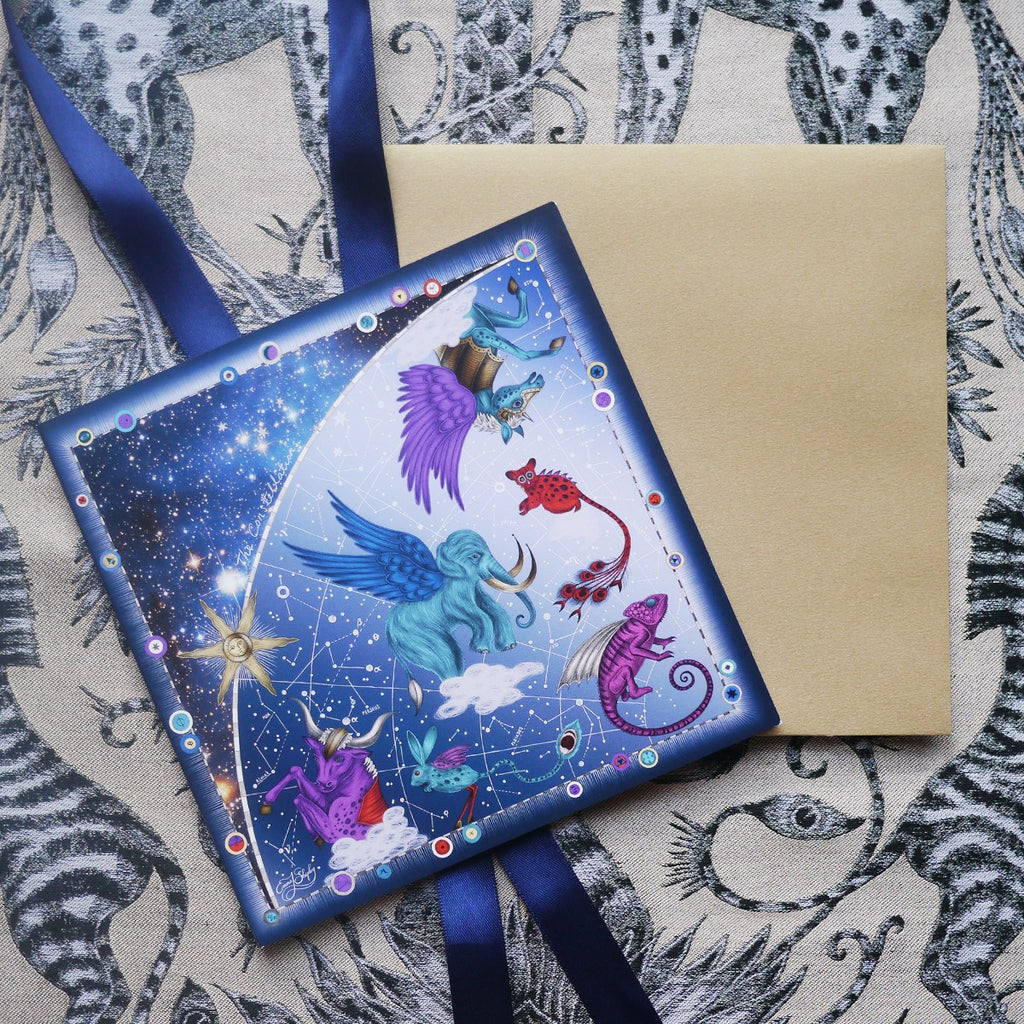 The gift card comes in the Constellation Greetings Card, in a gold envelope wrapped in navy satin ribbon.
