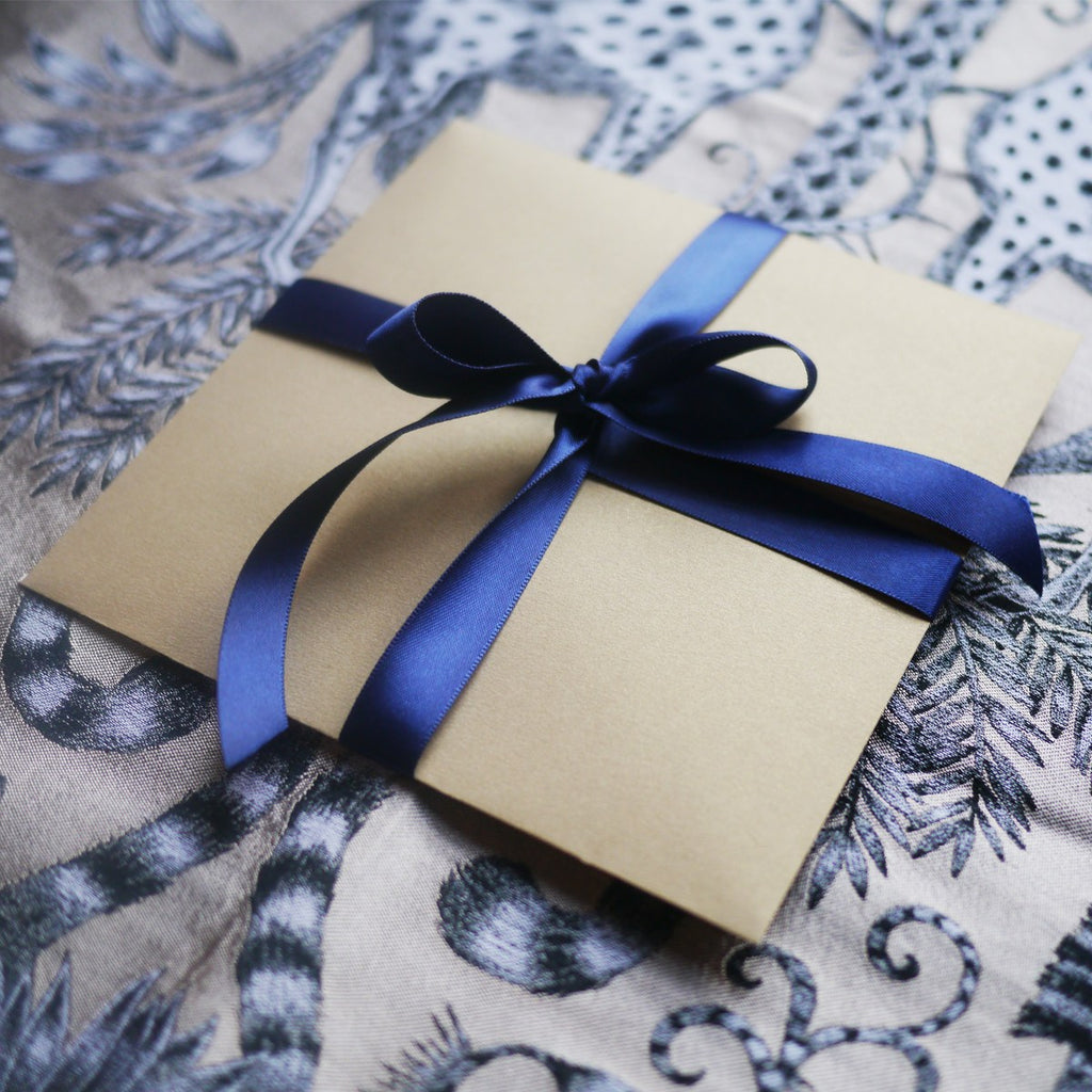 The Emma J Shipley gift card comes in the Constellation Greetings Card, in a gold envelope wrapped in navy ribbon.
