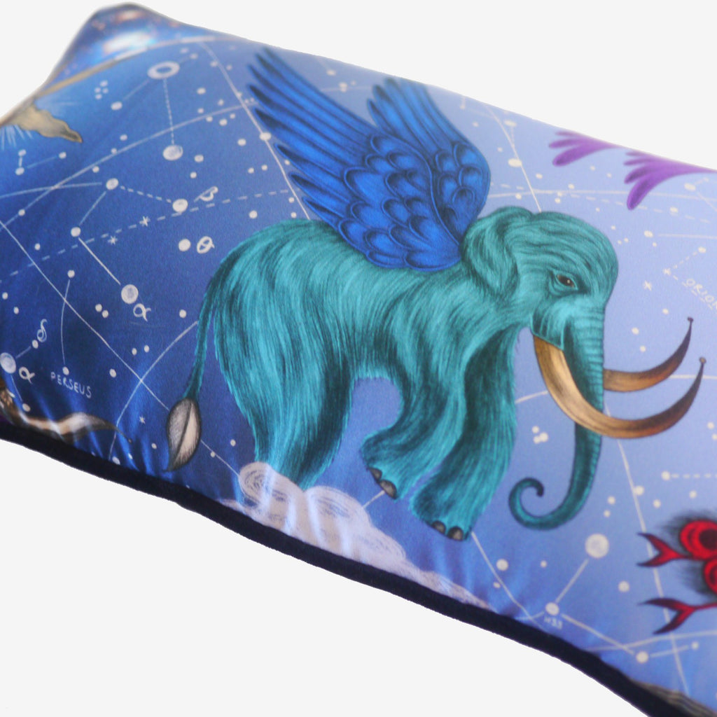 The detailed winged mammoth, hand-drawn and printed onto Emma J Shipley's Constellation Cushion